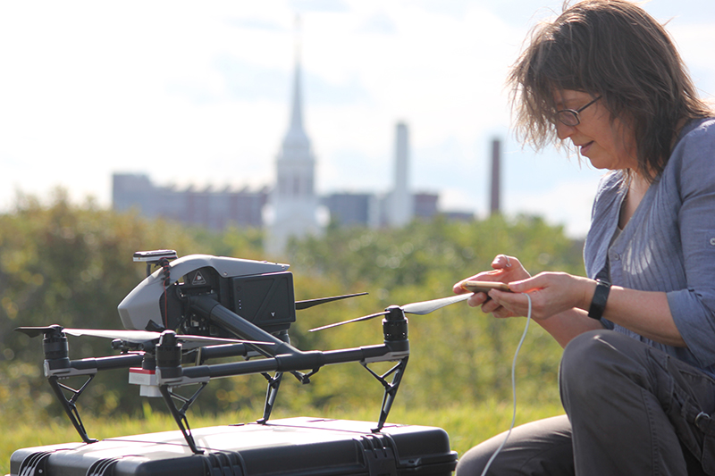 UConn Online Remote Sensing Graduate Certificate, PHd student collecting data from drone